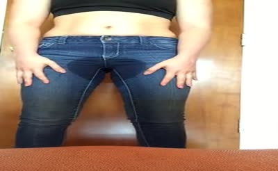 Girl Wetting Tight Blue Jeans