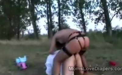 Adult baby gets pumped with his diapers down by strapon hottie outdoors