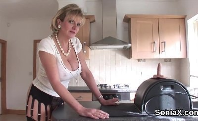 Adulterous british mature lady sonia exposes her large breasts