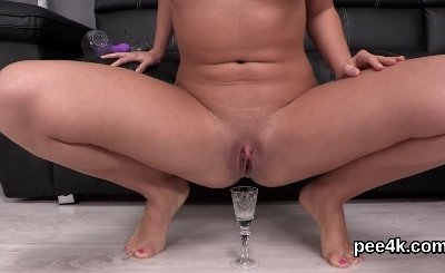 Attractive kitten is pissing and fingering trimmed snatch