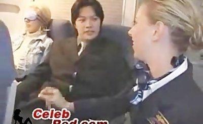 Blonde Stewardess Giving Handjob To Japanese Passenger  blonde