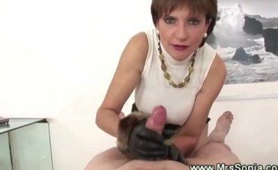 Classy cougar gives handjob then gets cumshot