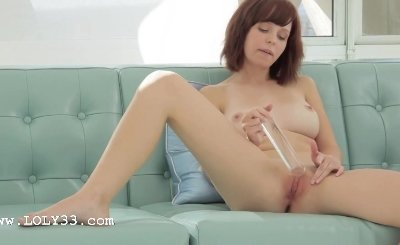 Glass vibrator in shaved pink pussy