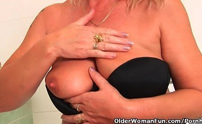 Granny With Big Tits Gives Her Old Pussy A Treat In The Shower