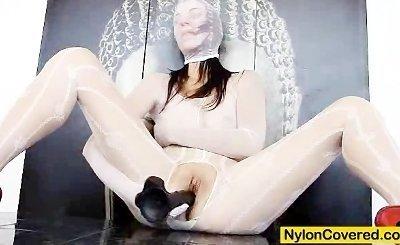 Hot brunette wears nylon mask to distort her face
