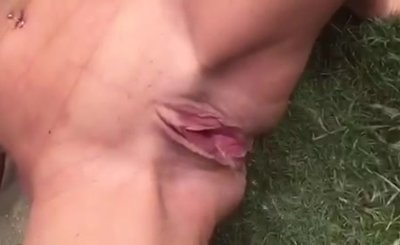 Katherine Brown showing off her huge tits while pissing