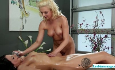 Lesbians Tiffany and Megan make out in the massage table