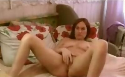 Mature Woman Masturbating In Bed