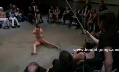 Men and women enjoy orgy with a sexy sex slave bound in leather spanking her in bondage sex video