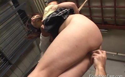 Oriental woman in short skirt tied with rope and fucked deep with toys