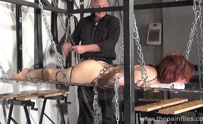 Redhead amateur slavegirl Bembys metal bondage
