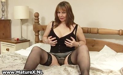 Ripe older lady with huge natural tits showing of her sexy lingerie by Matu
