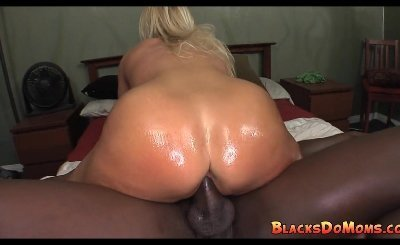 Thick blonde MILF enjoys black cock gangbang
