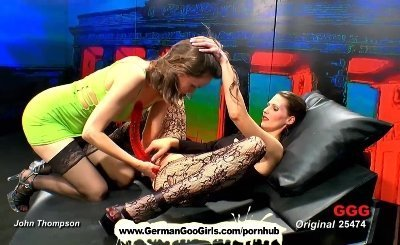Two brunette chicks having fun with cocks and a dildo