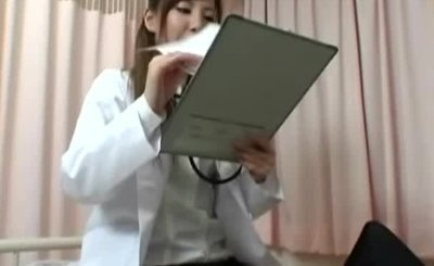 Young woman japanese doctor with patient